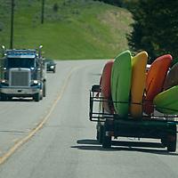 Traffic plies Montana State Route 64 to Big Sky, Montana.