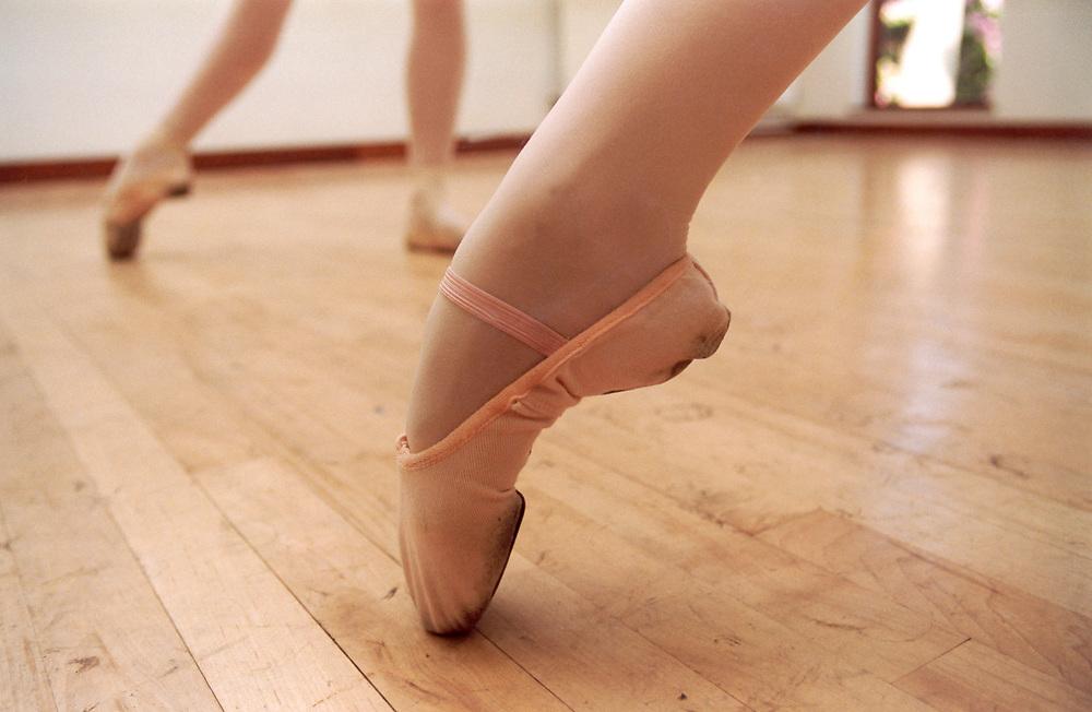 Close up of ballerina's foot & shoe; ballet / dance class; UK