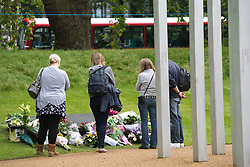 © London News Pictures. 07/07/2012. Mourners and members of the public lay flowers and pay their respects at the memorial to the victims of the July 7, 2005 London bombings in Hyde Park on July 7, 2012 in London. Today marks the 5 year anniversary of the terrorist attacks by four suicide bombers on the London Underground and a bus in Tavistock Square which claimed the lives of 52 people.  Photo credit: Ben Cawthra/LNP.