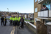 Police keeping two opposing groups separate on a local Dover estate as Anti Facist demonstrators march through Dover protesting against a facist demonstration also taking place in the port town. 30th January 2016
