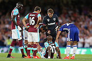 Andre Ayew of West Ham United is injured and goes off during the 1st half. Premier league match, Chelsea v West Ham United at Stamford Bridge in London on Monday 15th August 2016.<br /> pic by John Patrick Fletcher, Andrew Orchard sports photography.
