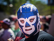 16 SEPTEMBER 2012 - PHOENIX, AZ: An Arizona Diamondbacks fan in a Lucha Libre wrestling mask at Hispanic Heritage Day in Phoenix. The Arizona Diamondbacks hosted their 14th Annual Hispanic Heritage Day, Sunday to kick off Hispanic Heritage Month (Sept. 15-Oct. 15) before the 1:10 p.m. game between the D-backs and San Francisco Giants. The main attraction of the Day was three Lucha Libre USA exhibition wrestling matches in front of Chase Field stadium before the game.  PHOTO BY JACK KURTZ