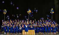 Gilford High School graduates tossing their caps following commencement on Saturday morning.  (Karen Bobotas/for the Laconia Daily Sun)