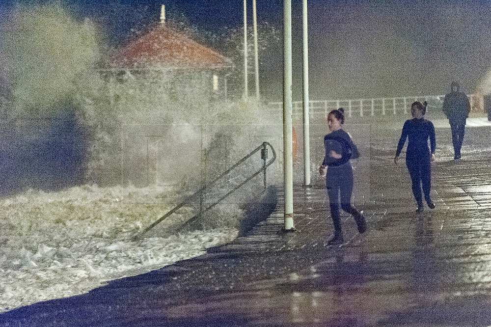 © Licensed to London News Pictures. 15/11/2020. Aberystwyth, Ceredigion, UK. On the evening high tide, gale force winds and massive waves continue to batter the Welsh seaside resort of Aberystwyth in Ceredigion, UK. Photo credit: Graham M. Lawrence/LNP
