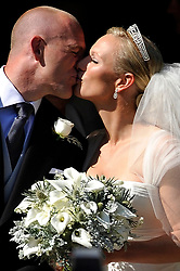 Zara Phillips and her new husband Mike Tindall kiss outside Canongate Kirk in Edinburgh after their wedding.