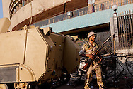 An Egyptian soldier standing on a street leading to Tahrir Square in Cairo