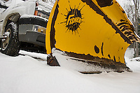 Plows stand at the ready as Thursday's storm begins with steady snowfall through the afternoon.  (Karen Bobotas/for the Laconia Daily Sun)
