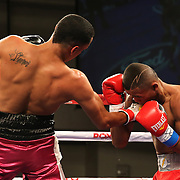 KISSIMMEE, FL - MARCH 06:  Edgardo Marin (L) trades punches with Alex Roman during the Telemundo Boxeo boxing match at the Kissimmee Civic Center on March 6, 2015 in Kissimmee, Florida. Marin won the bout on a split decision by the judges. (Photo by Alex Menendez/Getty Images) *** Local Caption *** Felix Verdejo; Sergio Villanueva
