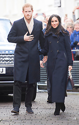 Prince Harry and Meghan Markle meet well-wishers as they arrive at the Nottingham Contemporary in Nottingham, to attend a Terrence Higgins Trust World AIDS Day charity fair on their first official engagement together.