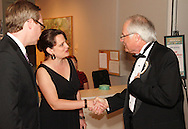 WSU President David Hopkins (right) greets patrons in the Stein Galleries during the 13th Annual ArtsGala at Wright State University's Creative Arts Center, Saturday, March 31, 2012.