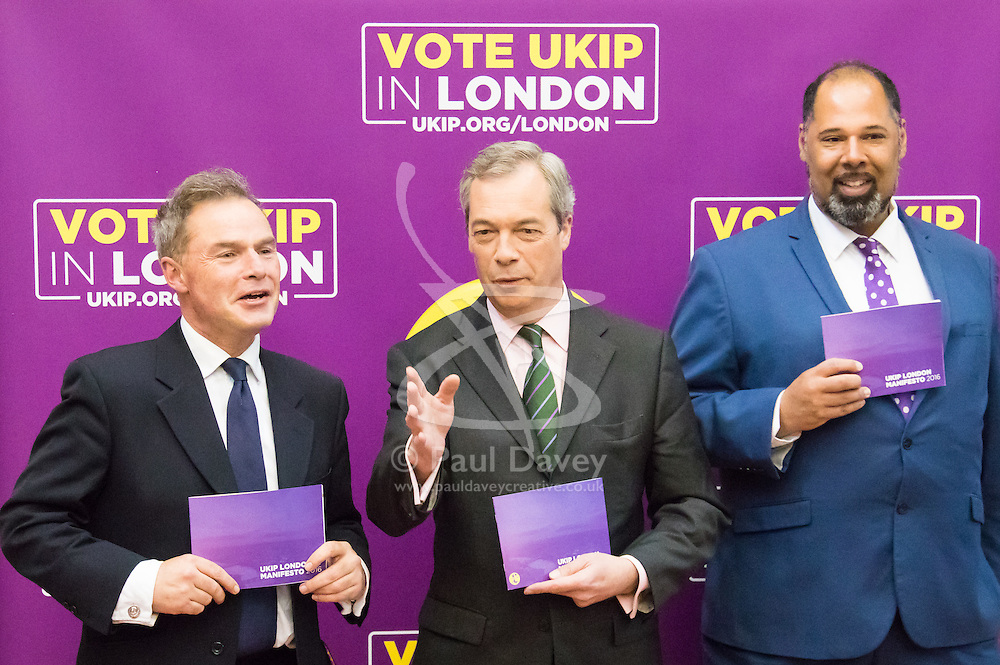 Emmanuel Centre, Westminster, London, April 19th 2016. UKIP Mayoral candidate, left, UKIP leader Nigel Farage and UKIP London Assembly candidate David Kurten pose for pictures as UKIP launches their London Mayoral campaign manifesto.