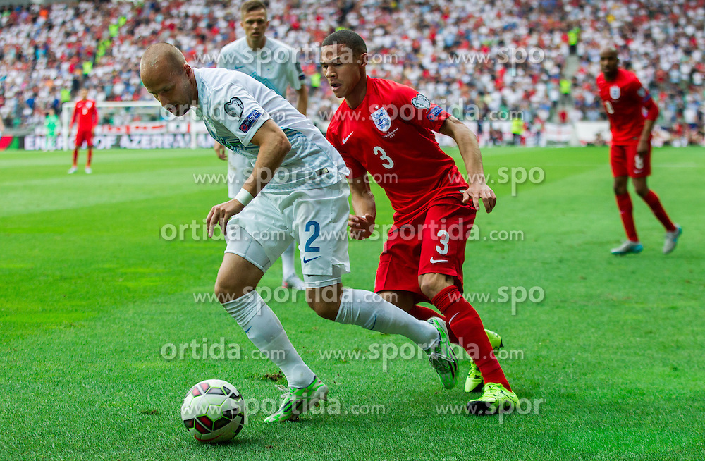 Miso Brecko of Slovenia vs Kieran Gibbs of England during the EURO 2016 Qualifier Group E match between Slovenia and England at SRC Stozice on June 14, 2015 in Ljubljana, Slovenia. Photo by Vid Ponikvar / Sportida