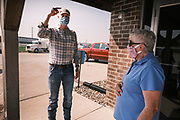 """22 SEPTEMBER 2020 - DUNLAP, IOWA: Congressional candidate J.D. SCHOLTEN talks to a Democratic voter at Dunlap Livestock Auction. Scholten, a Democrat from Sioux City, Iowa, ran against incumbent CongressmanSteve King (R-4th District Iowa) in 2018 and came within a few percentage points of upsetting the long serving conservative. King lost to Randy Feenstra, a Republican challenger, in the 2020 primary and Scholten is running against Feenstra in the 2020 general election on November 3. Iowa's 4th district, centered in the agricultural and sparsely populated northwest corner of the state, is the largest congressional district in Iowa and encompasses about ⅓ of the state of Iowa. Scholten is on his """"Every Town Tour 2020."""" He is visiting all 375 towns in the 39 counties in the district.     PHOTO BY JACK KURTZ"""