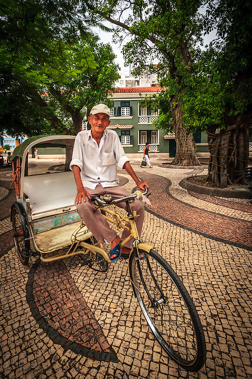 Trishaw or tricycle driver in Macau, China. Very slow but more romantic form of transport is a dying tradition in Macau.