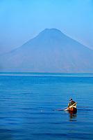 Fisherman plying the waters of Lake Atitlan, Western Highlands, Guatemala