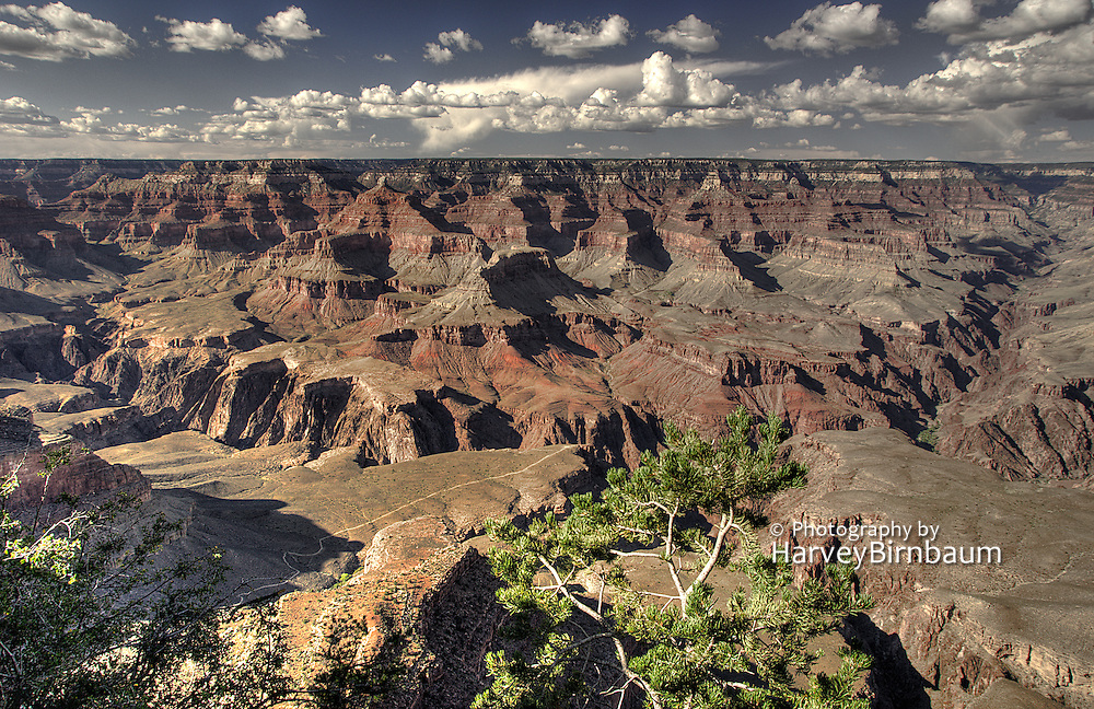 Dramatic Storm clouds, red sandstone buttes. Grand Canyon National Park, Arizona