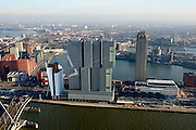 Nederland, Zuid-Holland, Rotterdam, 18-02-2015; Kop van Zuid met de Erasmusbrug gezien naar de Wilhelminapier en de Rijnhaven. Op de Wilhelminakade De Rotterdam, New Orleans en de laagbouw van Las Palmas.  <br /> Newly developed cultural center Kop van Zuid, urban renewal and modern architecture, high rise in a former harbour area<br /> luchtfoto (toeslag op standard tarieven);<br /> aerial photo (additional fee required);<br /> copyright foto/photo Siebe Swart