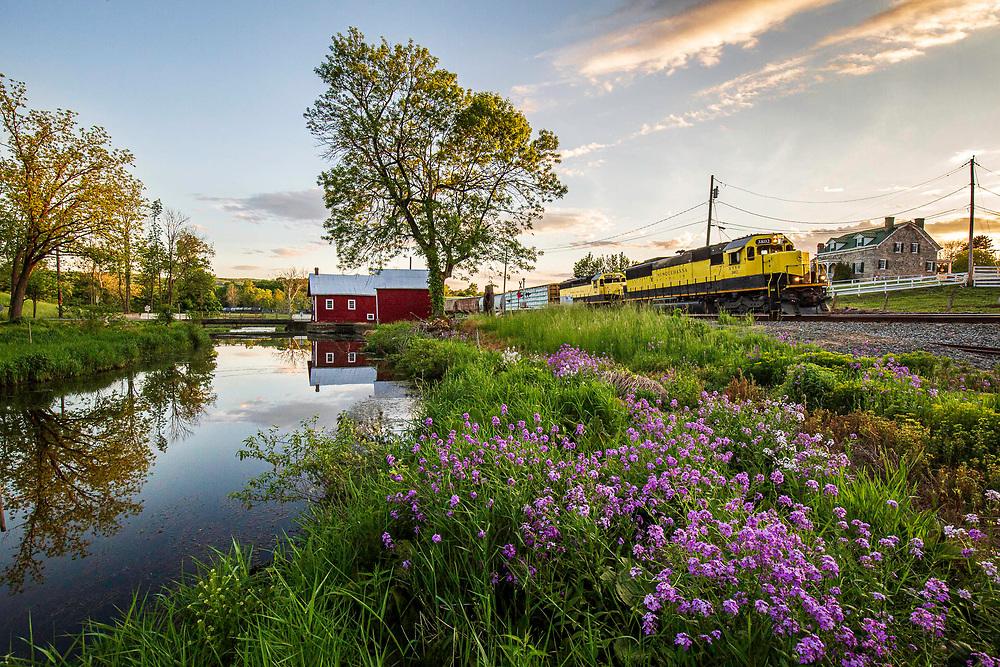 New York, Susquehanna and Western train SU-99 passes through Baird's Farm on the outskirts of Warwick, New York on June 1, 2020.