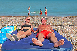 ©Licensed to London News Pictures 20/05/2020  <br /> Minster on sea, UK. Sunbathers on the beach. People enjoying their lockdown freedom with a day by the sea at Minster-on-sea on the Isle of Sheppey in Kent. Today is expected to be the hottest day of the year with temperatures in the South East of the UK to hit around 29C. Photo credit:Grant Falvey/LNP