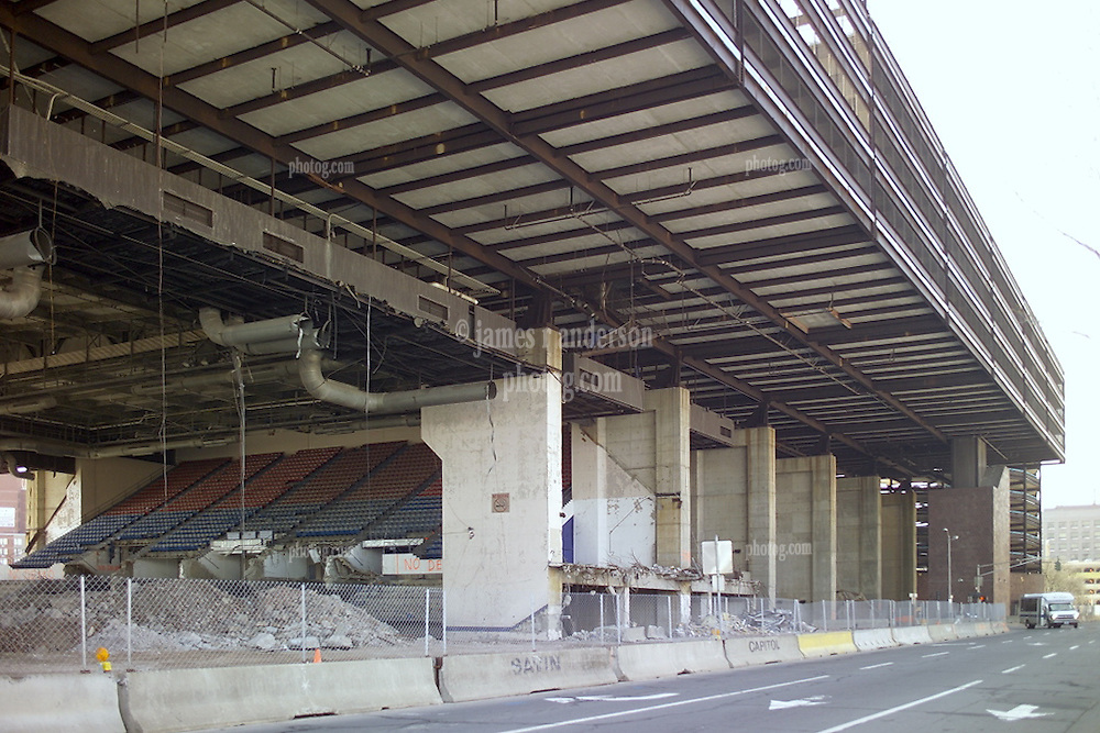 """Razing the New Haven Coliseum. Deconstruction Project as seen on 13 April 2006 from Crown Street. North Elevation showing under garage steel detail, support piers, rust and the escalators to access the parking garage above. The Garage was eventually """"Imploded"""" to ground level for removal."""