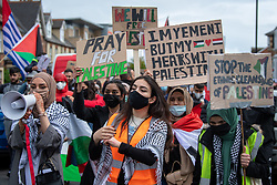 © Licensed to London News Pictures. 16/05/2021. Oxford, UK. People hold placards at the 'Speak up for Palestine' demonstration held in Oxford, the crowd marched on the planned route from Manzil Way to Bonn Square in central Oxford. Photo credit: Peter Manning/LNP