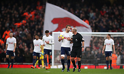 Tottenham Hotspur's Harry Kane talks with referee Mike Dean after they concede the opening goal of the game