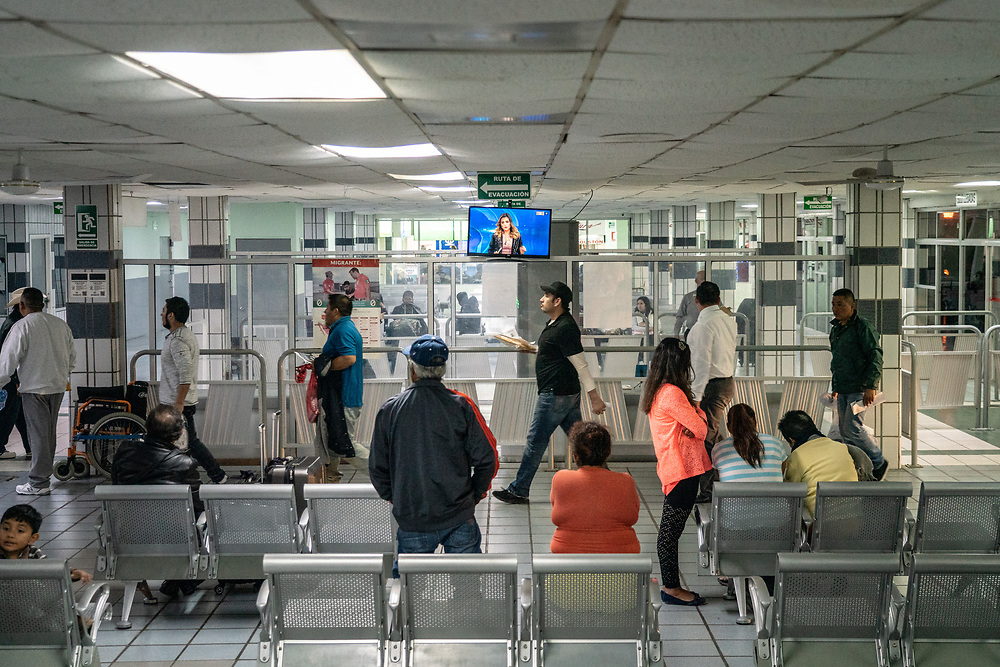 A group of migrants walk into the Central Bus Station after being deported to Mexico Jan 24, 2019 in Matamoros, Mexico. Many will be traveling by bus back to their respective countries in Central America.  Photo by Ken Cedeno/UPI