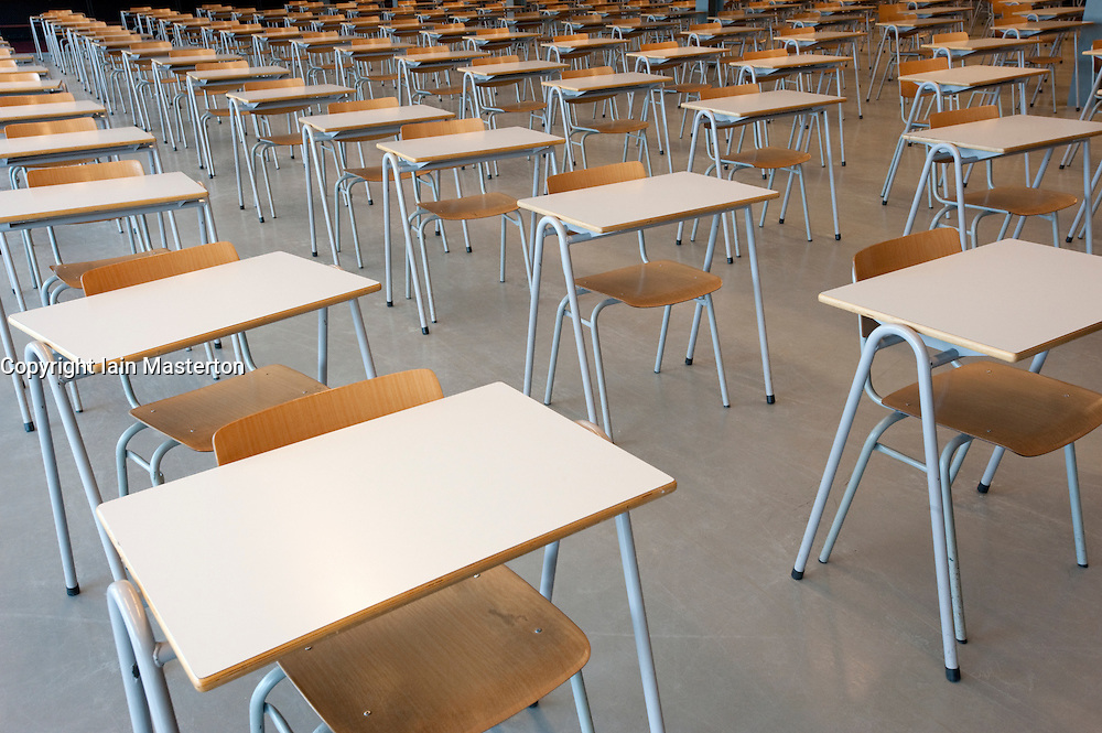 Many tables and chairs inside examination hall at university