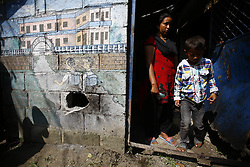 September 20, 2016 - Kathmandu, Nepal - Nepalese people pass by the hole of a wall after a pressure cooker bomb exploded it at Akashdeep School in Jorpati, Kathmandu, Nepal on Tuesday, September 20, 2016. Improvised explosive devices were placed in 7 schools as 2 bombs exploded. No human casualties have been reported in the explosions. (Credit Image: © Skanda Gautam via ZUMA Wire)