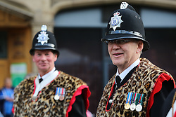 © Licensed to London News Pictures. 28/09/2016. Leeds, UK. Volunteer policemen wear a fearsome outfits at the olympic parade in Leeds. Yorkshire's Olympic and Paralympic stars receive a heroes' welcome during an open top bus parade in Leeds, West Yorkshire. . Photo credit : Ian Hinchliffe/LNP