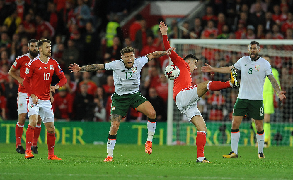Wales Tom Lawrence and Irelands Jeff Hendrick challenge for the header <br /> <br /> Photographer Ian Cook/CameraSport<br /> <br /> FIFA World Cup Qualifying - European Region - Group D - Wales v Republic of Ireland - Monday 9th October 2017 - Cardiff City Stadium - Cardiff<br /> <br /> World Copyright © 2017 CameraSport. All rights reserved. 43 Linden Ave. Countesthorpe. Leicester. England. LE8 5PG - Tel: +44 (0) 116 277 4147 - admin@camerasport.com - www.camerasport.com