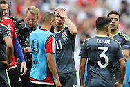 Gareth Bale of Wales looks on dejected at the end of match after his team lose.  Euro 2016, group B , England v Wales at Stade Bollaert -Delelis  in Lens, France on Thursday 16th June 2016, pic by  Andrew Orchard, Andrew Orchard sports photography.