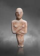 Post canonical female ancient Greek Cycladic figurine, Late Ccladic priod II to Cycladic period III (2500-2000 BC)Museum of Cycladic Art Athens, cat no 312.  Grey Background.