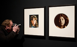 © Licensed to London News Pictures. 30/10/2012. London, UK. A photographer takes a close up picture of Nicky Bird's 'Jasmin, Ryde, Isle of Wight' (July 2000 - January 2001) (L) an image based on 'Kate Keown' (R circa 1866) by Julia Margaret Cameron at the press view for a new exhibition at the London based gallery today (30/10/12). The exhibition, entitled 'Seduced by Art: Photography Past and Present', running from 31 October 2012 - 20 January 2013, is the National Gallery's first major exhibition of photography and examines the relationship between photography and traditional fine art painting. Photo credit: Matt Cetti-Roberts/LNP