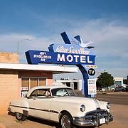 Blue Swallow Motel in Tucumcari, New Mexico with vintage Pontiac Eight car
