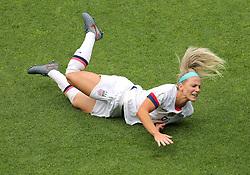 USA's Julie Ertz falls to the floor