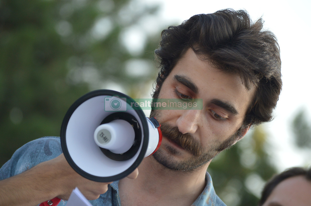 August 15, 2017 - Ankara, Turkey - A man speaks into a megaphone as activists gathered in front of the main gate of the Middle East Technical University (METU) to protest against the development of the university's natural habitat, chanting the slogan 'METU must be defended' in Ankara, Turkey on August 15, 2017. The university and its students are known for their dissenting opinion as the university's forest land has become a target for the new construction in the last years. (Credit Image: © Altan Gocher/NurPhoto via ZUMA Press)
