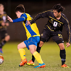 BRISBANE, AUSTRALIA - AUGUST 26: Jake McLean of the Strikers and Donggyu Lee of Moreton Bay compete for the ball during the NPL Queensland Senior Men's Semi Final match between Brisbane Strikers and Moreton Bay Jets at Perry Park on August 26, 2017 in Brisbane, Australia. (Photo by Patrick Kearney)