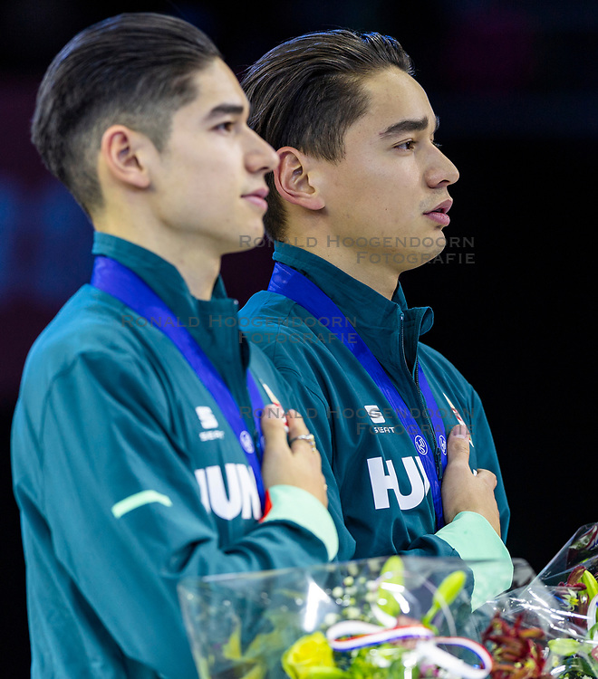 12-01-2019 NED: ISU European Short Track Championships 2019 day 2, Dordrecht<br /> (L-R) Shaoang Liu and Shaolin Sandor Liu of Hungary pose in the Men's 1500m medal ceremony during the ISU European Short Track Speed Skating Championships
