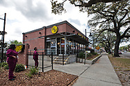 Waffel house in New Orleans  LA  next to th eTulane medical center now only serving take out only due to coronavirus pandemic. Two women who work at the hospital come to get takeout.