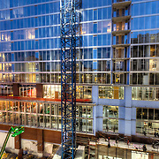 Construction progress on One Light Tower in downtown Kansas City, Missouri in March 2015. Residential tower construction at 13th & Walnut, co-developed by Cordish Company and Kushner Companies, construction by general contractor JE Dunn.