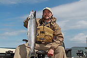 Fisherman with an Atlantic salmon caught in Chequamegon Bay of western Lake Superior.