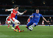 Arsenal's Hector Belerin tussles with Leicester's Robert Huth during the Premier League match at the Emirates Stadium, London. Picture date: April 26th, 2017. Pic credit should read: David Klein/Sportimage