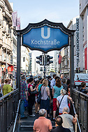 Berlin, Germany - August 31, 2015: People walk out of the Kochstrasse U-Bahn station at Checkpoint Charlie in Berlin, Germany. Checkpoint Charlie was a famous crossing point between East and West Berlin during the Cold War