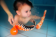 Baby boy of 6 months underwater in a swimming pool