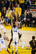 Golden State Warriors guard Shaun Livingston (34) and Golden State Warriors forward Draymond Green (23) contend a lay up by Cleveland Cavaliers forward LeBron James (23) during Game 5 of the NBA Finals at Oracle Arena in Oakland, Calif., on June 12, 2017. (Stan Olszewski/Special to S.F. Examiner)