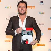 NLD/Utrecht/20181001 - Buma NL Awards 2018, Tino Martin neemt de Sena Ouevreprijs in ontvangst