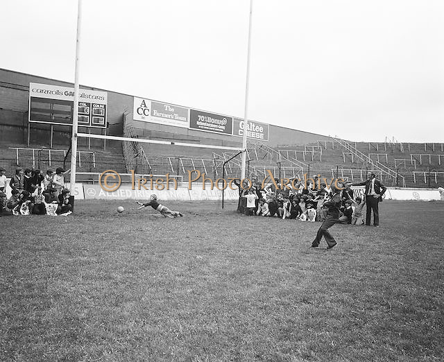 A group of children take turns of taking shots at the goal during a visit to Croke Park during a Kells Educational Tour on the 12th of June 1975.