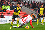 Yasin Ben El-Mhanni of Scunthorpe United (19) dribbles past Danny Andrew of Doncaster Rovers (3) during the EFL Sky Bet League 1 match between Doncaster Rovers and Scunthorpe United at the Keepmoat Stadium, Doncaster, England on 15 December 2018.