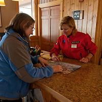 An advisor discusses Big Sky recreation opportunities at The Base Camp, Big Sky Resort, Montana